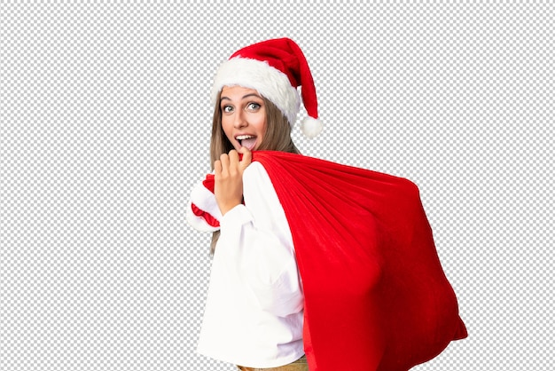 Junge blonde frau, die voll eine tasche der geschenke aufhebt Premium PSD