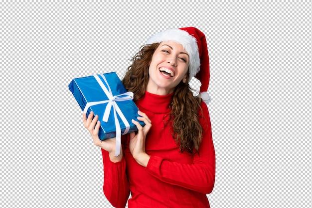 Junge frau mit weihnachtsmütze Premium PSD