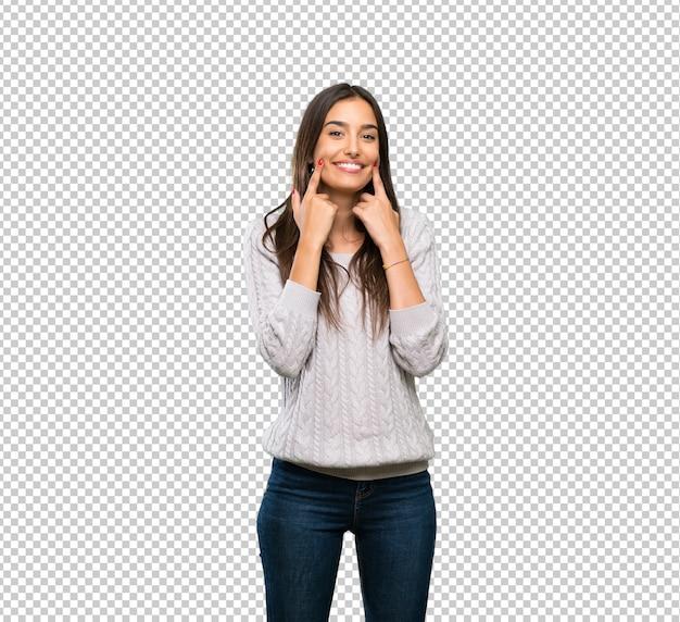 Junge hispanische brunettefrau, die mit einem glücklichen und angenehmen ausdruck lächelt Premium PSD