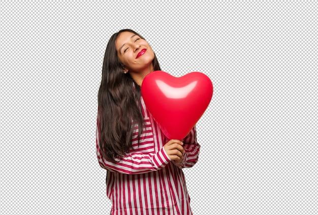 Junge indische frau, die valentinsgrußtag feiert Premium PSD