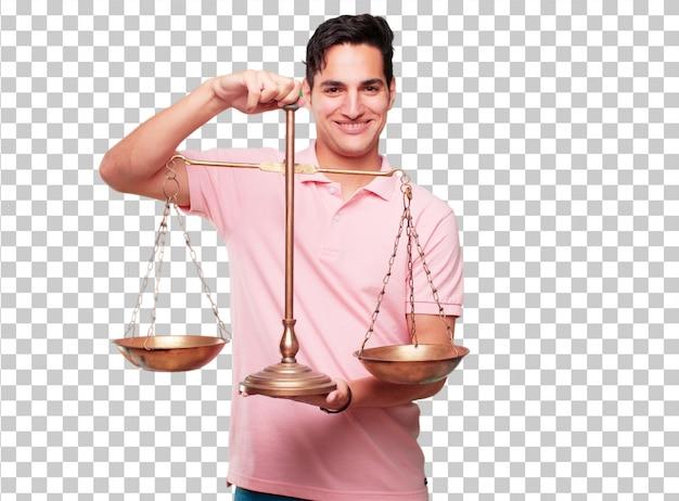 Junger hübscher gebräunter mann mit einer gerechtigkeitbalance oder -skala Premium PSD