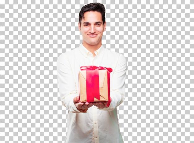 Junger hübscher gebräunter mann mit geschenkboxkonzept Premium PSD