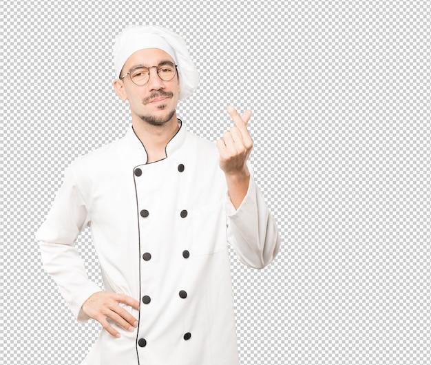 Junger koch, der eine geste der sorge um seine wirtschaft macht Premium PSD