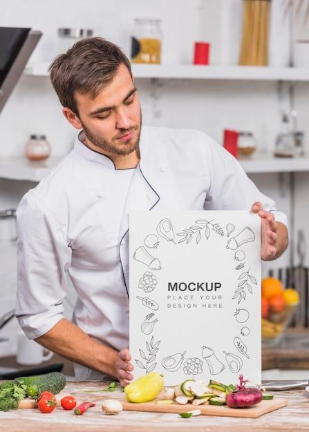 Junger koch im küchenmodell Kostenlosen PSD