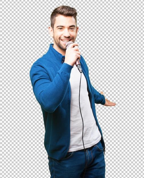 Junger mann, der mit einem mikrofon singt Premium PSD