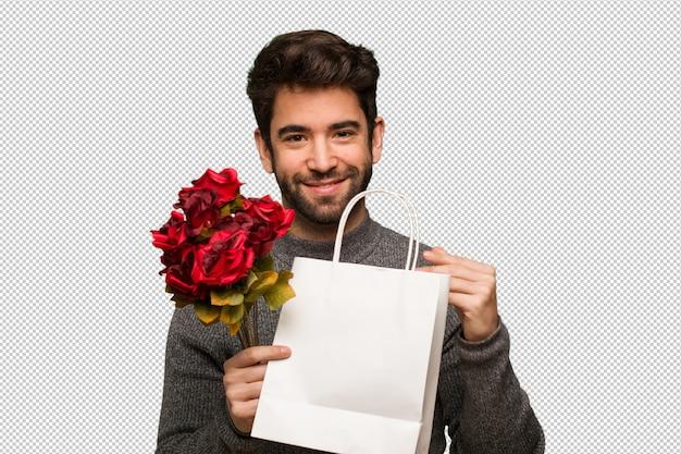 Junger mann, der valentinsgrußtag feiert Premium PSD