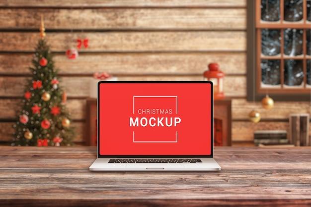 Laptop-modell auf dem weihnachtsmann-schreibtisch Premium PSD