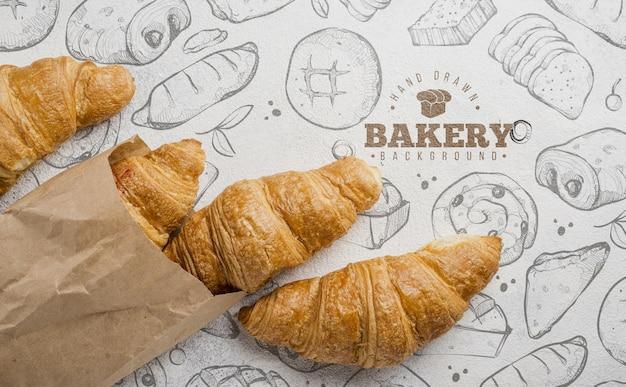 Leckere croissants auf dem tisch Kostenlosen PSD