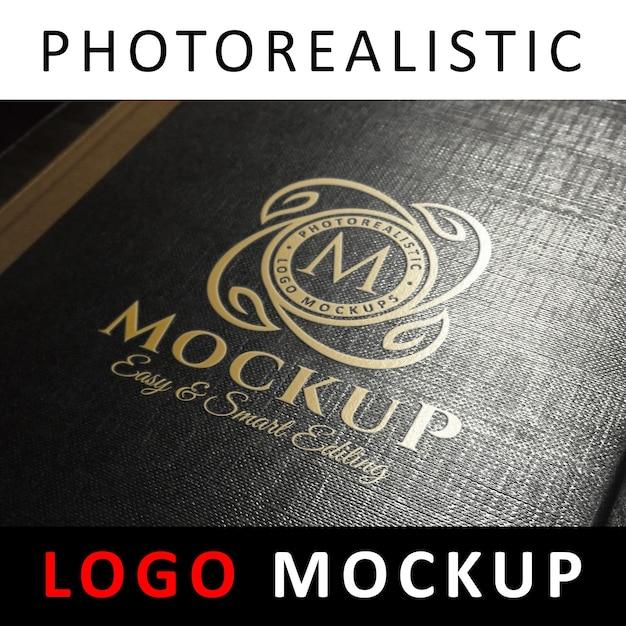 Logo mock up - goldfolienprägung logo auf schwarzem buchumschlag Premium PSD