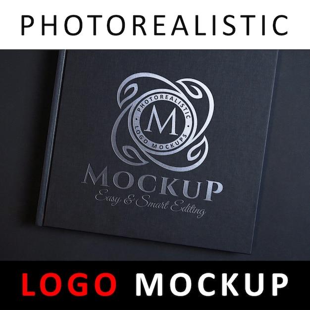 Logo mockup - silberfolienprägung logo auf schwarzem deckel Premium PSD