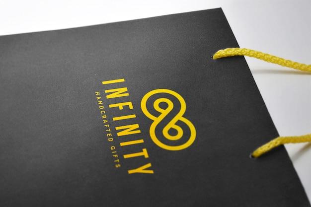 Logo-modell auf einer harten papiertüte Premium PSD