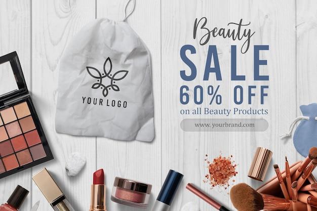 Logo-modell auf kosmetikdekoration Premium PSD