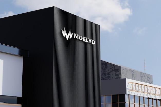 Logo-modell auf schwarzem fassadengeschäft-bürogebäudezeichen Premium PSD