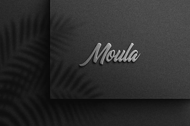 Logo-modell auf schwarzem papier Premium PSD