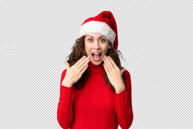Mädchen mit weihnachtshut mit überraschungsgesichtsausdruck Premium PSD