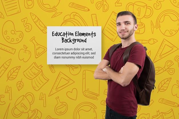 Männlicher student mit verschränkten armen Kostenlosen PSD