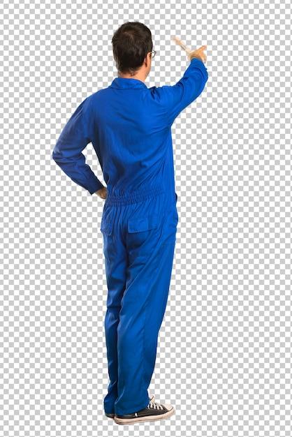Malermann, der zurück mit dem zeigefinger zeigt Premium PSD