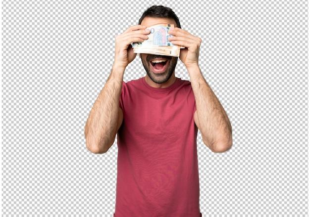 Mann, der eine menge geldbedeckung durch hände nimmt. überrascht zu sehen, was vor uns liegt Premium PSD