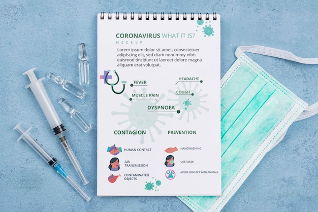 Medizinischer schreibtisch mit notizbuch und masken Kostenlosen PSD