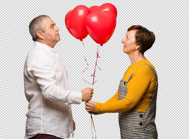 Mitte gealterte paare, die valentinsgrußtag feiern Premium PSD
