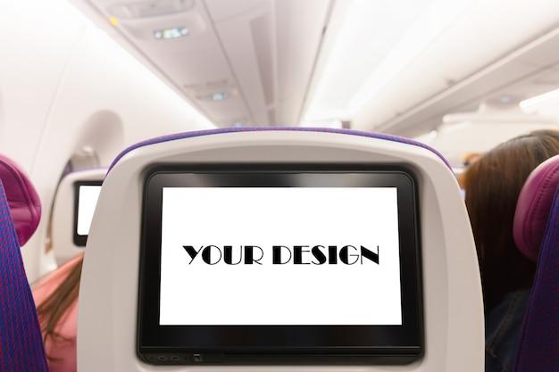Modell des flugzeugmonitors auf kabine im passagiersitzflächeninnenraum Premium PSD