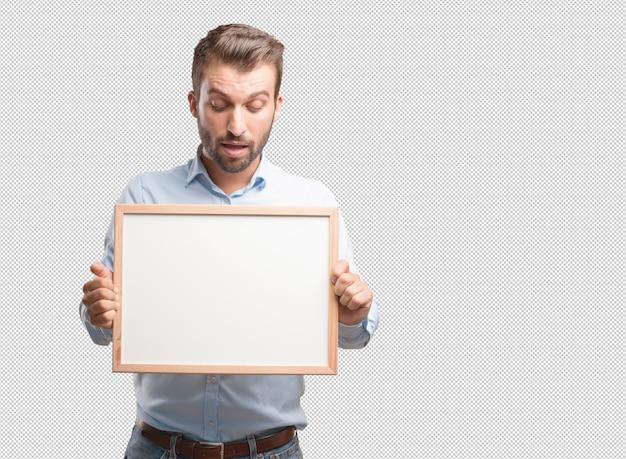 Moderner mann mit whiteboard Premium PSD