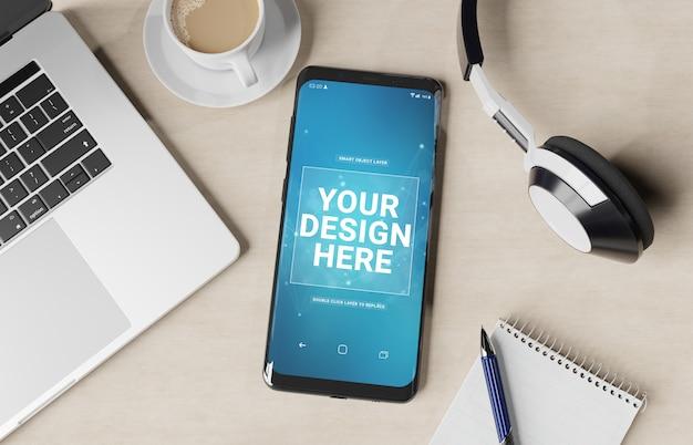 Modernes smartphone, das auf ein destop-modell legt Premium PSD