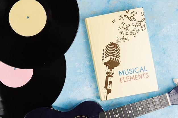 Musikelemente buchen mit vinyl- und ukulelegitarre Kostenlosen PSD