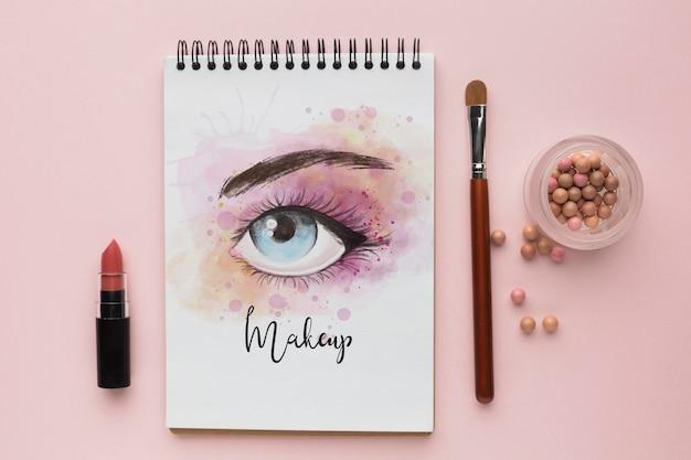 Notizbuch mit make-up für augenkonzept Kostenlosen PSD