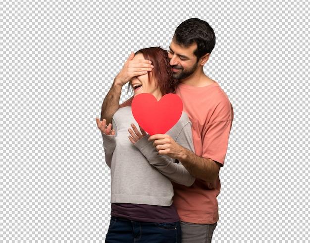 Paare am valentinstag, der ein herzsymbol hält Premium PSD