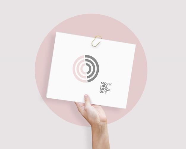 Paper in hand mockup Premium PSD