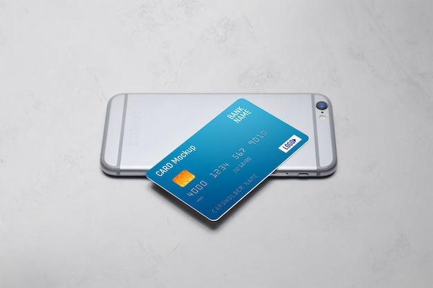 Plastikkarte auf einem telefonmodell Premium PSD
