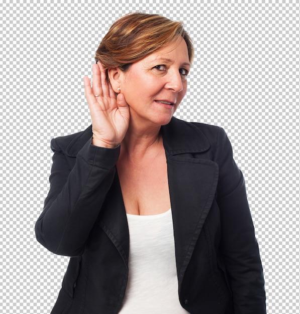 Porträt einer reifen geschäftsfrau, die auf etwas hört Premium PSD