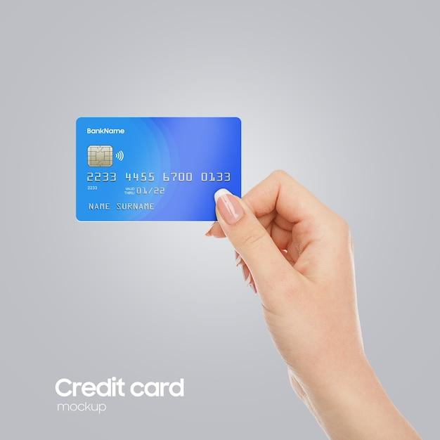 Realistische plastikkarte an hand mockup Premium PSD