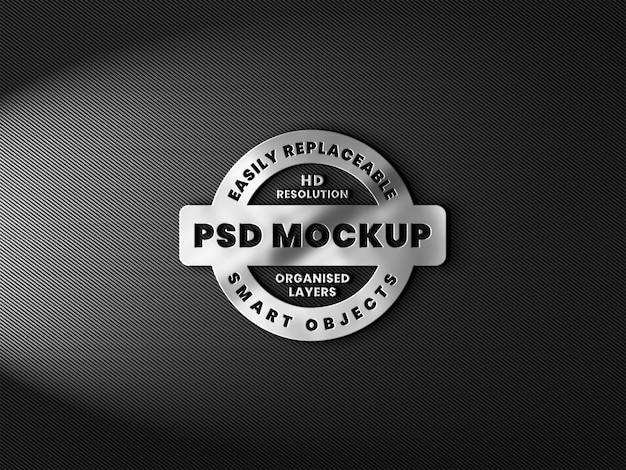 Realistisches 3d-logo-modell mit metallischer textur und reflexion auf kohlefaser Premium PSD