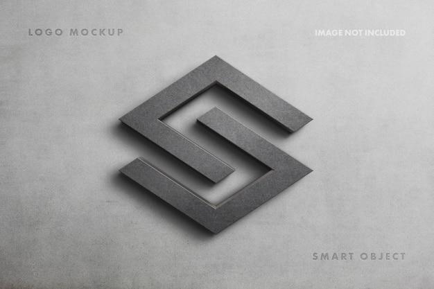 Realistisches steinzeichenlogo-modell auf betonwand Premium PSD