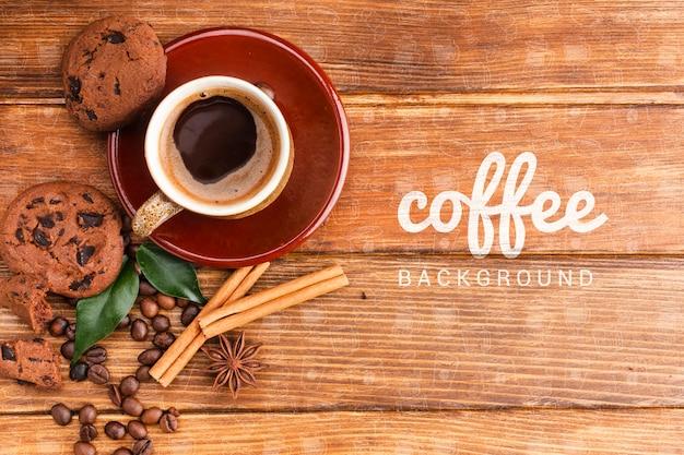 Rustikaler hintergrund mit kaffeetasse und plätzchen Kostenlosen PSD