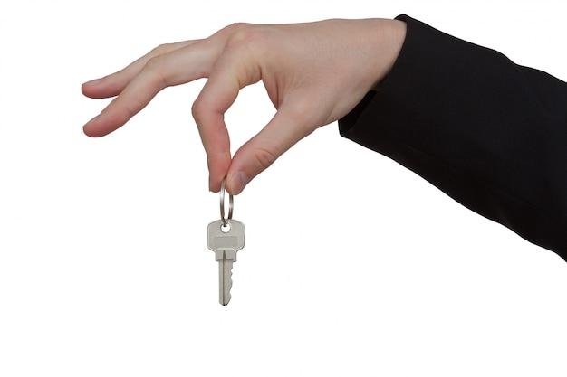 Schlüssel in der hand auf einem weißen hintergrund Premium PSD