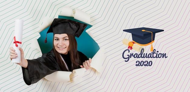 Schöner student, der diplom hält Premium PSD