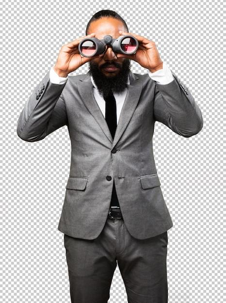 Schwarzer mann des geschäfts, der ferngläser hält Premium PSD