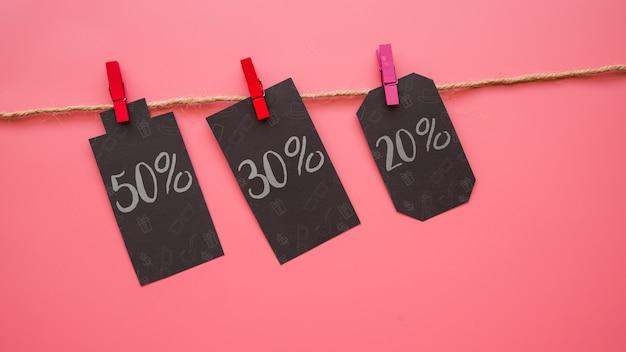 Schwarzes freitag-modell mit aufklebern auf wäscheleine Kostenlosen PSD