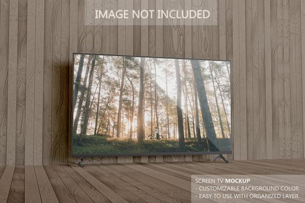 Smart-tv-bildschirm modell auf den holzbrettern Premium PSD