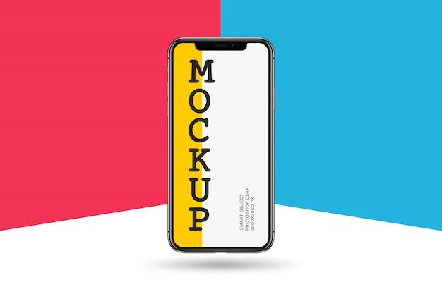 Smartphone-modell auf buntem hintergrund Premium PSD