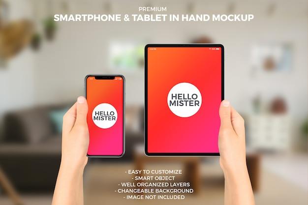 Smartphone und tablet im handmodell Premium PSD