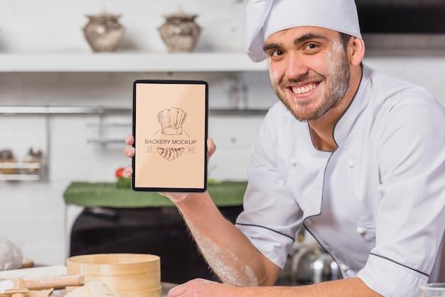 Smiley-koch im küchenmodell Kostenlosen PSD