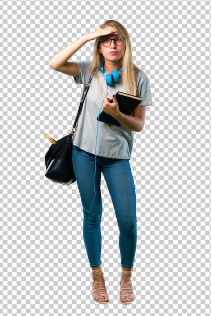 Studentenmädchen mit den gläsern, die weit weg mit der hand schauen, um etwas zu schauen Premium PSD
