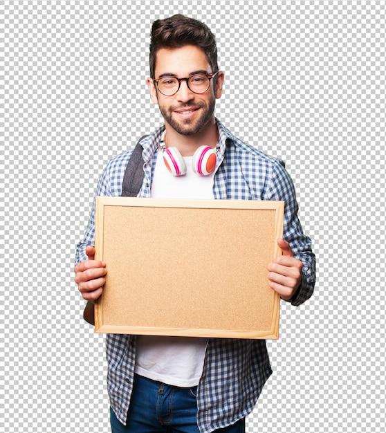 Studentenmann, der ein corkboard hält Premium PSD