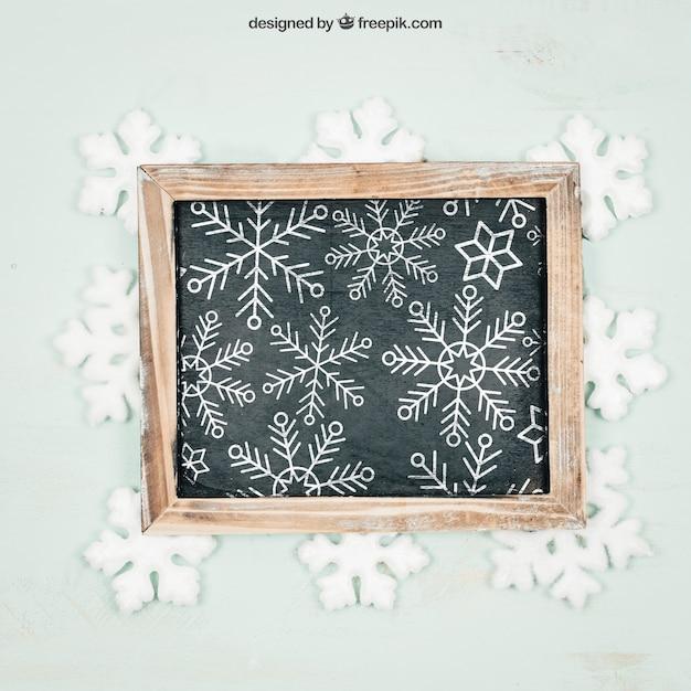Tafel mit schneeflockenmodell mit christmtas design Kostenlosen PSD