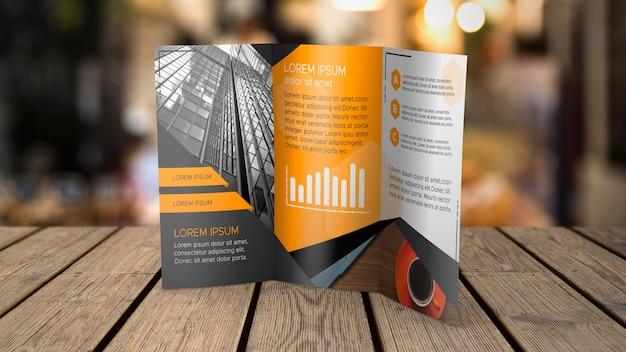 Trifold broschürenmodell auf tischplatte Kostenlosen PSD