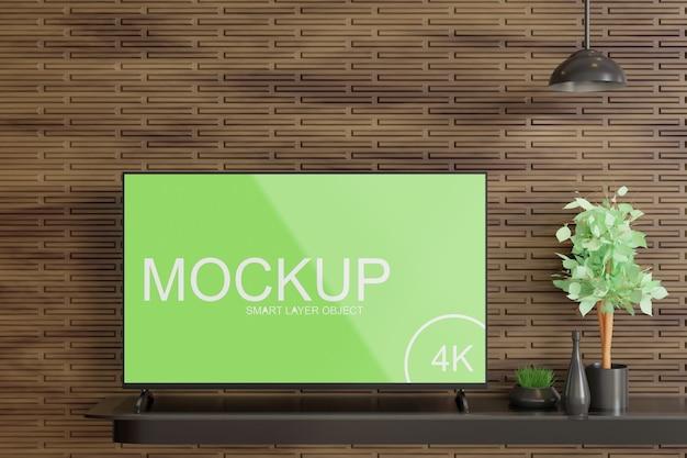Tv-display-modell auf dem holzwandtisch Premium PSD